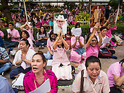 13 OCTOBER 2016 - BANGKOK, THAILAND: People pray for the King of Thailand shortly before his death was announced at Siriraj Hospital. Thousands of people came to the hospital to pray for the beloved monarch. Bhumibol Adulyadej, the King of Thailand, died at Siriraj Hospital in Bangkok Thursday, October 13, 2016. Bhumibol Adulyadej, 5 December 1927 – 13 October 2016, was the ninth monarch of Thailand from the Chakri Dynasty and is known as Rama IX. He became King on June 9, 1946 and served as King of Thailand for 70 years, 126 days. He was, at the time of his death, the world's longest-serving head of state and the longest-reigning monarch in Thai history.       PHOTO BY JACK KURTZ