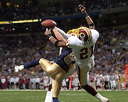 Washington Redskins safety Sean Taylor (21) brakes up a pass in the end zone from St. Louis Rams wide receiver Kevin Curtis (83), during the Redskins 24-9 win at the Edward Jones Dome in St. Louis, Missouri, December 4, 2005.