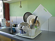 dishes drying in rack on countertop