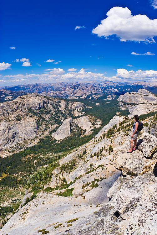 Climber on the summit of Tenaya Peak, Tuolumne Meadows area, Yosemite National Park, California