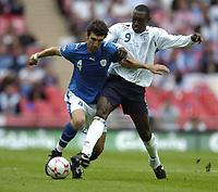 Photo: Jonathan Butler.<br /> England v Israel. UEFA European Championships Qualifying. 08/09/2007.<br /> Emile Heskey of England tackles Ariel Benado of Israel.