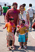 Indian family atl Hindu Holi festival of colours with powder paints at Nariman Point in Mumbai, India
