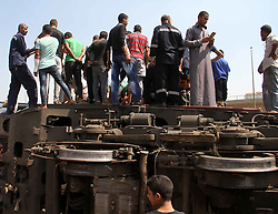 CAIRO, Sept. 7, 2016 (Xinhua) -- People climb on the derailed train to search for survivors in the district of Ayat in Giza, Egypt on Sept. 7, 2016. A train derailment accident in Egypt's Giza governorate killed five people and injured 27 others on Wednesday, reported the state-run MENA news agency. .(Xinhua/STR)(yk) (Credit Image: © Str/Xinhua via ZUMA Wire)