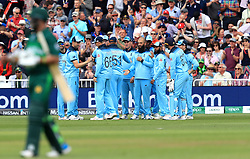 England's Chris Woakes (second left) celebrates the catch of Pakistan's Imam-ul-Haq (not pictured) with team mates during the ICC Cricket World Cup group stage match at Trent Bridge, Nottingham.