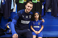 Mascot with favourite player during the EFL Sky Bet League 1 match between AFC Wimbledon and Peterborough United at the Cherry Red Records Stadium, Kingston, England on 18 January 2020.