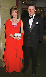 VISCOUNT & VISCOUNTESS ASTOR at a dinner in London on 19th May 1999.MSF 27