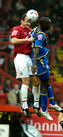 Photo: Ed Godden.<br />Bristol City v Doncaster Rovers. Coca Cola League 1. 28/10/2006. Bristol's Louis Carey (L) and Doncaster's  Jonathan Forte go for the ball.
