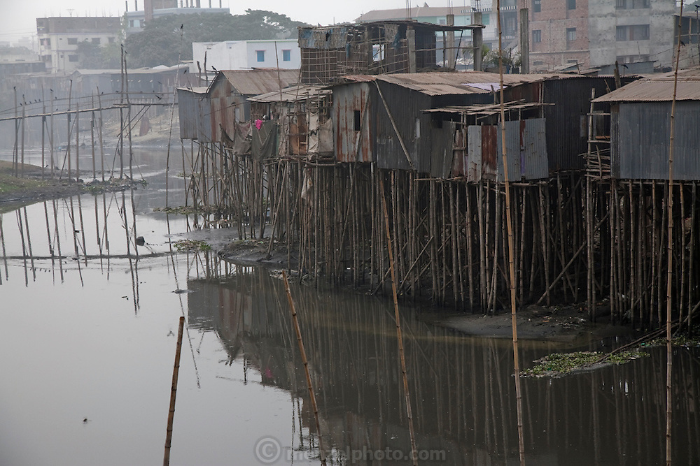 A slum settlement sits on a tributary of the Buriganga river near Ruma Akhter's home in the Chairman District of Dhaka, Bangladesh.  (Ruma Akhter is featured in the book What I Eat: Around the World in 80 Diets.)