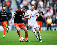 Paul Coutts of Sheffield Utd in a action with Dean Lewington of MK Dons during the English League One match at  Stadium MK, Milton Keynes. Picture date: April 22nd 2017. Pic credit should read: Simon Bellis/Sportimage