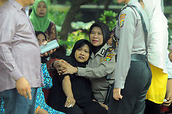 May 25, 2017 - Jakarta, Jakarta, Indonesia - Ning Wiyarti (46) Mother (C) of Indonesia policeman Imam Gilang Adinata, a victim of a bomb blast at Kampung Melayu bus station, mourns near his coffin in Jakarta, Indonesia, May 25, 2017.Imam Gilang Adinata, the victim of a bomb explosion buried in Klaten, Central Java. Dasril Roszandi  (Credit Image: © Dasril Roszandi/NurPhoto via ZUMA Press)