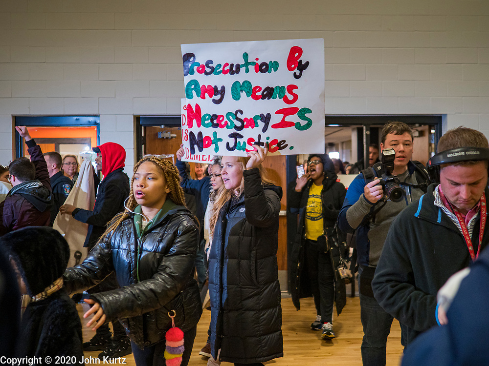 01 MARCH 2020 - ST. LOUIS PARK, MINNESOTA: Black Lives Matter protesters enter the gym at St. Louis Park High School to disrupt Sen. Amy Klobuchar's campaign rally. Dozens of Black Lives Matter (BLM) protesters disrupted Sen. Amy Klobuchar's last presidential election rally in Minnesota before Super Tuesday. Almost 500 Klobuchar supporters came to hear Sen. Klobuchar, when the BLM protesters marched into the hall and took control of the stage. Klobuchar cancelled the event about an hour after the BLM protesters entered the hall. The protesters targeted Klobuchar because while she was the Hennepin County Attorney, she oversaw the conviction of Myon Burrell, a black teenager accused and convicted of murder. Evidence has come to light since his conviction that suggests he was wrongly convicted. His conviction has become a flashpoint in Minnesota politics.      PHOTO BY JACK KURTZ