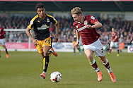 Northampton Town Midfielder Lee Martin under pressure from Cambridge United Defender Darnell Furlong  during the Sky Bet League 2 match between Northampton Town and Cambridge United at Sixfields Stadium, Northampton, England on 12 March 2016. Photo by Dennis Goodwin.