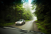 Two cars pass each other on Cascade River Road in Mount Baker-Snoqualmie National Forest, Washington.