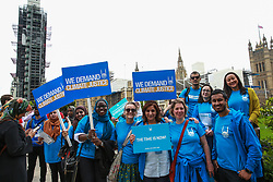 London, UK. 26 June, 2019. Climate change activists from Islamic Relief attend a mass lobby of Parliament for the climate and environment.