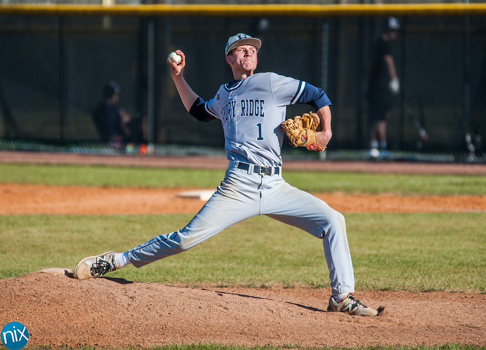 Hickory Ridge's Collin Sprinkle (1) pitches against Hickory Grove Christian Tuesday afternoon the Cox Mill Spring Tournament. The Ragin' Bulls won the game 13-3 in five innings.