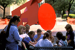 Young women taking an art lesson in park