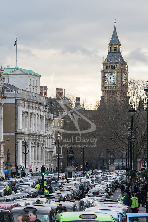 Whitehall, London, February 10th 2016. Big ben looks down on the river of taxis blocking Whitehall as an estimated 8,000 cabbies hold a go-slow in protest against what they say is unfair competition from minicab and Uber drivers who do not have to undergo the rigorous training and checks required for the licenced taxi trade. ///FOR LICENCING CONTACT: paul@pauldaveycreative.co.uk TEL:+44 (0) 7966 016 296 or +44 (0) 20 8969 6875. ©2015 Paul R Davey. All rights reserved.