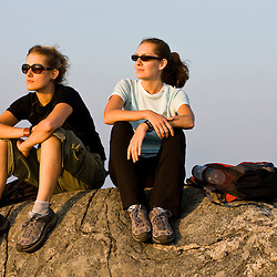 Two women hikers on the summit of Mount Monadnock in Monadnock State Park in Jaffrey, New Hampshire.