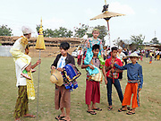 Preparing for the procession at a Shinbyu Novice Ceremony on 21st March 2016 in Mo Bye village, Shan State, Myanmar. In Myanmar, it is customary for boys to enter the monastery as a Buddhist novice between the age of ten and 20 years old although they can be as young as four, for at least one week.