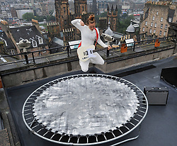 """Pictured: Performer Zoe Ni Riordain complete with guitar limbers up on her trampoline atop Camera Obscura before her Fringe show 'Everything I do""""<br /> <br /> Fringe performers final preparations for the start of the 2019 Fringe.<br /> <br /> © Dave Johnston / EEm"""