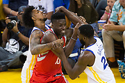 Golden State Warriors guard Nick Young (6) and Golden State Warriors forward Draymond Green (23) foul Houston Rockets center Clint Capela (15) during Game 6 of the Western Conference Finals at Oracle Arena in Oakland, Calif., on May 26, 2018. (Stan Olszewski/Special to S.F. Examiner)