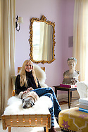 "The Portland, Oregon home of Wendy Burden, author of  the memoir, Dead End Gene Pool. Ms. Burden in her living room, seated on a Bruno Mathesson chaise.  The bust is by William Ordway Partridge, her great-grandfather (on her father's side).  Her dog, ""Spit,"" is with her."