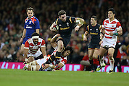 Alex Cuthbert of Wales tries to make a break. Under Armour 2016 series international rugby, Wales v Japan at the Principality Stadium in Cardiff , South Wales on Saturday 19th November 2016. pic by Andrew Orchard, Andrew Orchard sports photography
