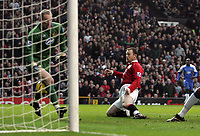 Photo: Paul Thomas.<br /> Manchester United v Wigan Athletic. The Barclays Premiership. 26/12/2006.<br /> <br /> Wayne Rooney (Red) has his shot saved by Wigan Keeper  Chris Kirkland (Green).