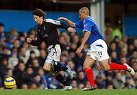 Fotball<br /> Premier League 2004/05<br /> Portsmouth v Chelsea<br /> 28. desember 2004<br /> Foto: Digitalsport<br /> NORWAY ONLY<br /> Alexei Smertin, on loan at Portsmouth last season, is chased by Nigel Quashie