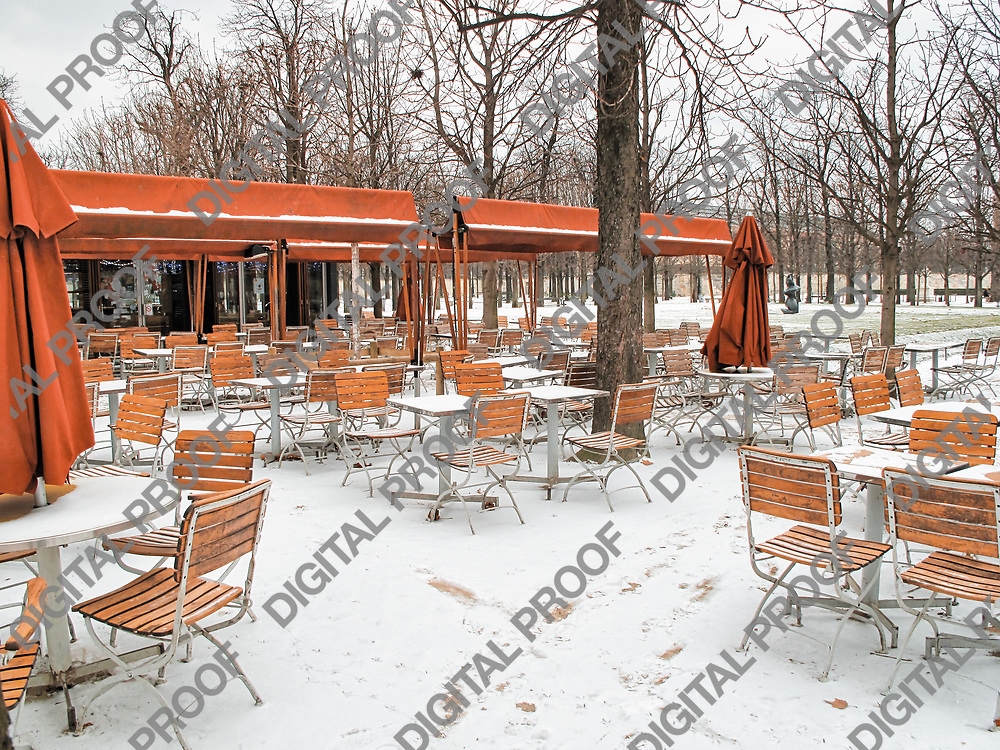 Cafe in the Tuileries Garden in Paris with snow during winter season