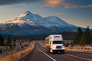 Mount Shasta and semi-tractor trailer truck on rural highway, Siskiyou County, California