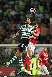 April 22, 2017 - Lisbon, Portugal - Sporting's Dutch forward Bas Dost (L) heads the ball with Benfica's Swedish defender Victor Lindelof during the Portuguese League football match Sporting CP vs SL Benfica at the Alvadade stadium in Lisbon on April 22, 2017. (Credit Image: © Pedro Fiuza/NurPhoto via ZUMA Press)