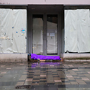 Homeless people sleeping on streets of Glasgow. A person lies sleeping in a doorway on Sauchiehall Street, Glasgow. <br /> <br /> Picture Robert Perry 17th March 2017<br /> <br /> Must credit photo to Robert Perry<br /> FEE PAYABLE FOR REPRO USE<br /> FEE PAYABLE FOR ALL INTERNET USE<br /> www.robertperry.co.uk<br /> NB -This image is not to be distributed without the prior consent of the copyright holder.<br /> in using this image you agree to abide by terms and conditions as stated in this caption.<br /> All monies payable to Robert Perry<br /> <br /> (PLEASE DO NOT REMOVE THIS CAPTION)<br /> This image is intended for Editorial use (e.g. news). Any commercial or promotional use requires additional clearance. <br /> Copyright 2014 All rights protected.<br /> first use only<br /> contact details<br /> Robert Perry     <br /> 07702 631 477<br /> robertperryphotos@gmail.com<br /> no internet usage without prior consent.         <br /> Robert Perry reserves the right to pursue unauthorised use of this image . If you violate my intellectual property you may be liable for  damages, loss of income, and profits you derive from the use of this image.