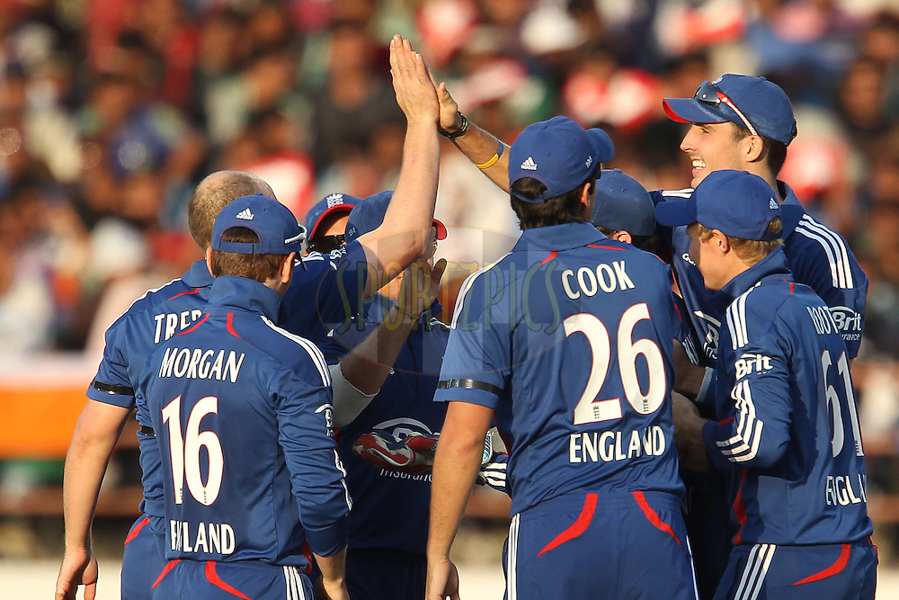 James Tredwell of England celebrates the wicket of Gautam Gambhir of India during the 1st Airtel ODI Match between India and England held at the SAURASHTRA CRICKET ASSOCIATION STADIUM, RAJKOT, India on the 11th January 2013..Photo by Ron Gaunt/BCCI/SPORTZPICS ..Use of this image is subject to the terms and conditions as outlined by the BCCI. These terms can be found by following this link:..http://www.sportzpics.co.za/image/I0000SoRagM2cIEc