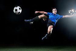 Dec. 05, 2012 - Young soccer player leaping into air to kick ball (Credit Image: © Image Source/ZUMAPRESS.com)