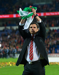 CARDIFF, WALES - Tuesday, October 13, 2015: Wales' manager Chris Coleman celebrates qualifying for the finals after a 2-0 victory over Andorra during the UEFA Euro 2016 qualifying Group B match at the Cardiff City Stadium. (Pic by Ian Cook/Propaganda)