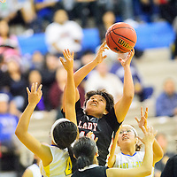 011514  Adron Gardner/Independent<br /> <br /> Crownpoint Eagle Tia Charley (42) grasps a rebound from the Zuni Thunderbirds in Zuni Wednesday.