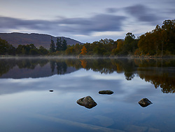 Dawn mist lingers over the waters of Loch Ness