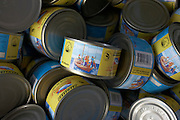 Tinned tuna steak in oil lie in baskets at the shop of state-run MIFCO who export 100% Maldivian seafoods to Europe and Asia .
