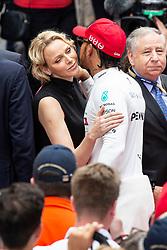 Lewis Hamilton say hello to Princess Charlene of Monaco along the grid lane at the 77th Monaco Grand Prix, Monaco on May 26th, 2019. Photo by Marco Piovanotto/ABACAPRESS.COM