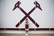 a Young West Ham United fan poses for a photo next to the Iron Cross outside London Stadium before k/o. Premier league match, West Ham Utd v AFC Bournemouth at the London Stadium, Queen Elizabeth Olympic Park in London on Sunday 21st August 2016.<br /> pic by John Patrick Fletcher, Andrew Orchard sports photography.
