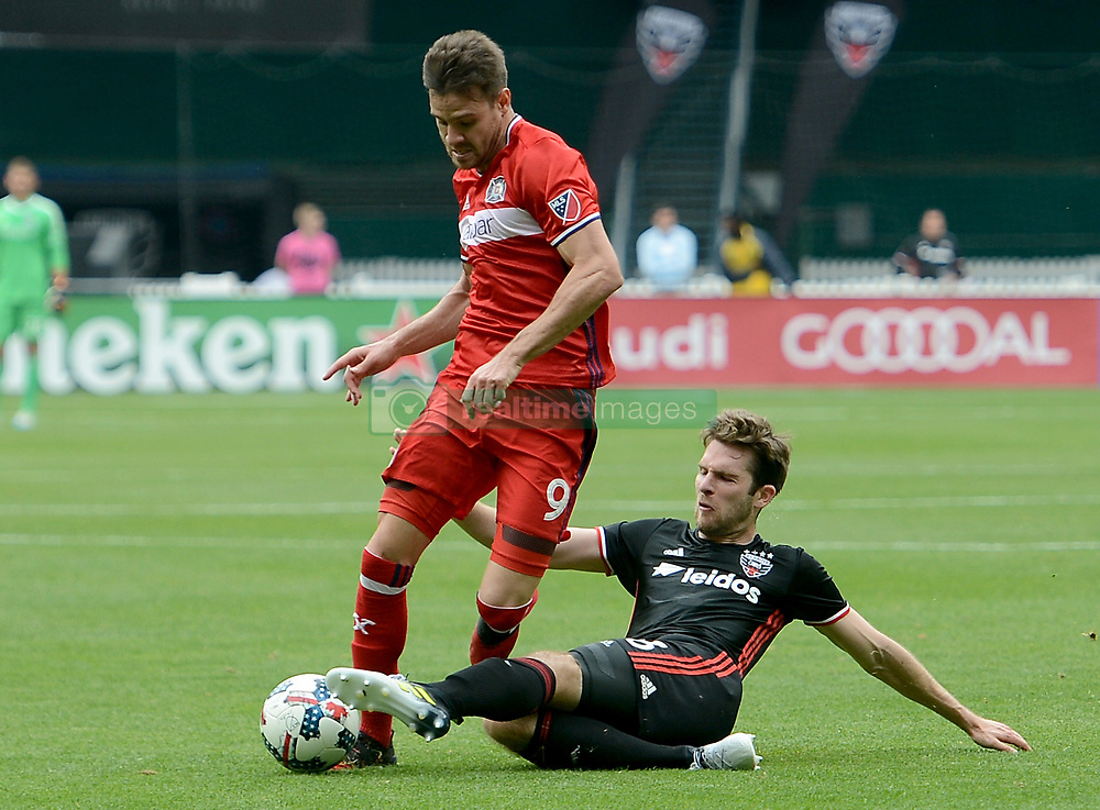 May 20, 2017 - Washington, DC, USA - 20170520 - D.C. United forward PATRICK MULLINS (16) makes a defensive play against Chicago Fire forward LUIS SOLIGNAC (9) in the first half at RFK Stadium in Washington. (Credit Image: © Chuck Myers via ZUMA Wire)