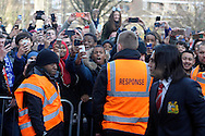 fans outside stadium as Manchester United players arrive before k/o. Barclays Premier league match, Queens Park Rangers v Manchester Utd at Loftus Road in London on Saturday 17th Jan 2015. pic by John Patrick Fletcher, Andrew Orchard sports photography.
