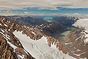The carved out terrain of glacial action near Mount cook.  Gorilla Range with Lake Pukaki in the distance, near Mount Cook, New Zealand