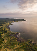 Aerial view of green coastline on the island of Vormsi in Estonia at sunset