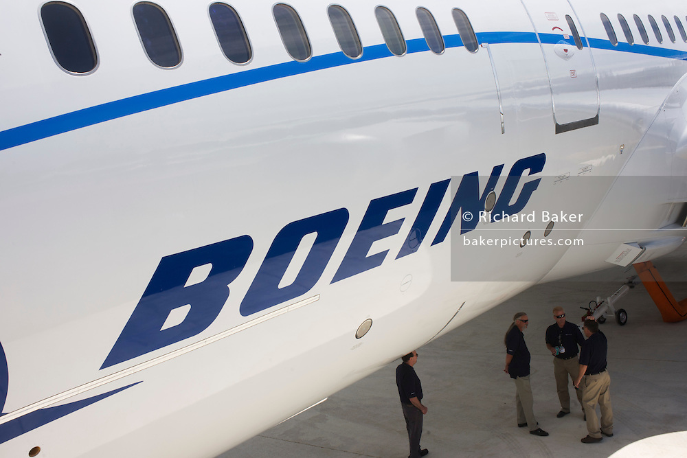 Boeing employees beneath company 787 Dreamliner (N787BX) at the Farnborough Airshow.