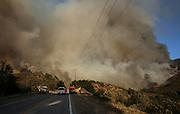 Smoke rises from a wildfire near Placenta Caynon Road in Santa Clarita, Calif., Sunday, July 24, 2016.(AP Photo/Ringo H.W. Chiu)
