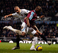 Photo: Ed Godden.<br /> West Ham United v Manchester United. The Barclays Premiership. 17/12/2006. Man Utd's Anton Ferdinand (L), challenges Marlon Harewood.