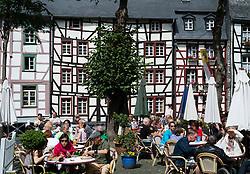 Busy restaurant in Marrktplatz in historic village of Monschau in Germany