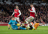 Football - 2019 / 2020 Premier League - Arsenal vs. Wolverhampton Wanderers<br /> <br /> Diogo Jota (Wolverhampton Wanderers) collides with Bernd Leno (Arsenal FC) as they both go for the ball at The Emirates Stadium.<br /> <br /> COLORSPORT/DANIEL BEARHAM